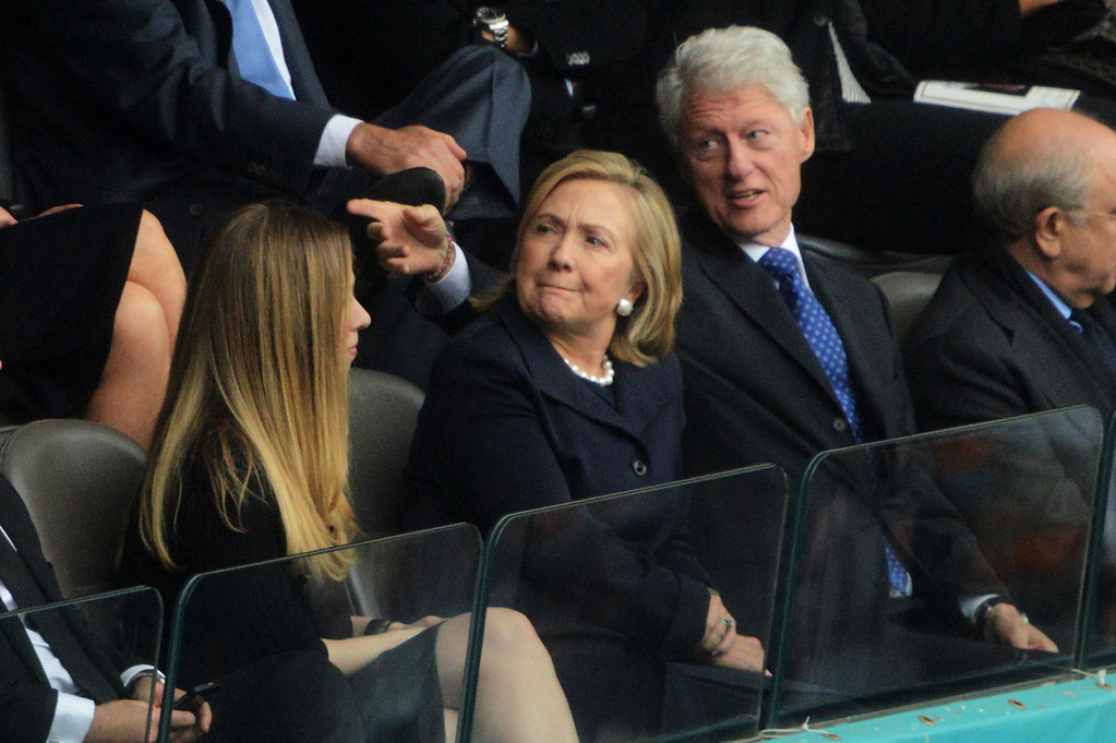 . Former US President Bill Clinton (R), Former US Secretary of State Hillary Clinton (C), and their daughter Chelsea attend the memorial service of South African former president Nelson Mandela at the FNB Stadium (Soccer City) in Johannesburg on December 10, 2013. Mandela, the revered icon of the anti-apartheid struggle in South Africa and one of the towering political figures of the 20th century, died in Johannesburg on December 5 at age 95.  ROBERTO SCHMIDT/AFP/Getty Images