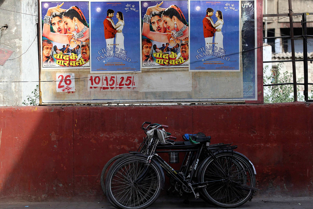 ". Posters for a low budget Hindi film are pasted onto the wall of a cinema in Meerut in the northern Indian state of Uttar Pradesh April 28, 2013. Indian cinema marks 100 years since Dhundiraj Govind Phalke\'s black-and-white silent film ""Raja Harishchandra\"" (King Harishchandra) held audiences spellbound at its first public screening on May 3, 1913, in Mumbai. Indian cinema, with its subset of Bollywood for Hindi-language films, is now a billion-dollar industry that makes more than a thousand films a year in several languages. It is worth 112.4 billion rupees (over $2 billion) and leads the world in terms of films produced and tickets sold. Picture taken April 28, 2013. REUTERS/Anindito Mukherjee"