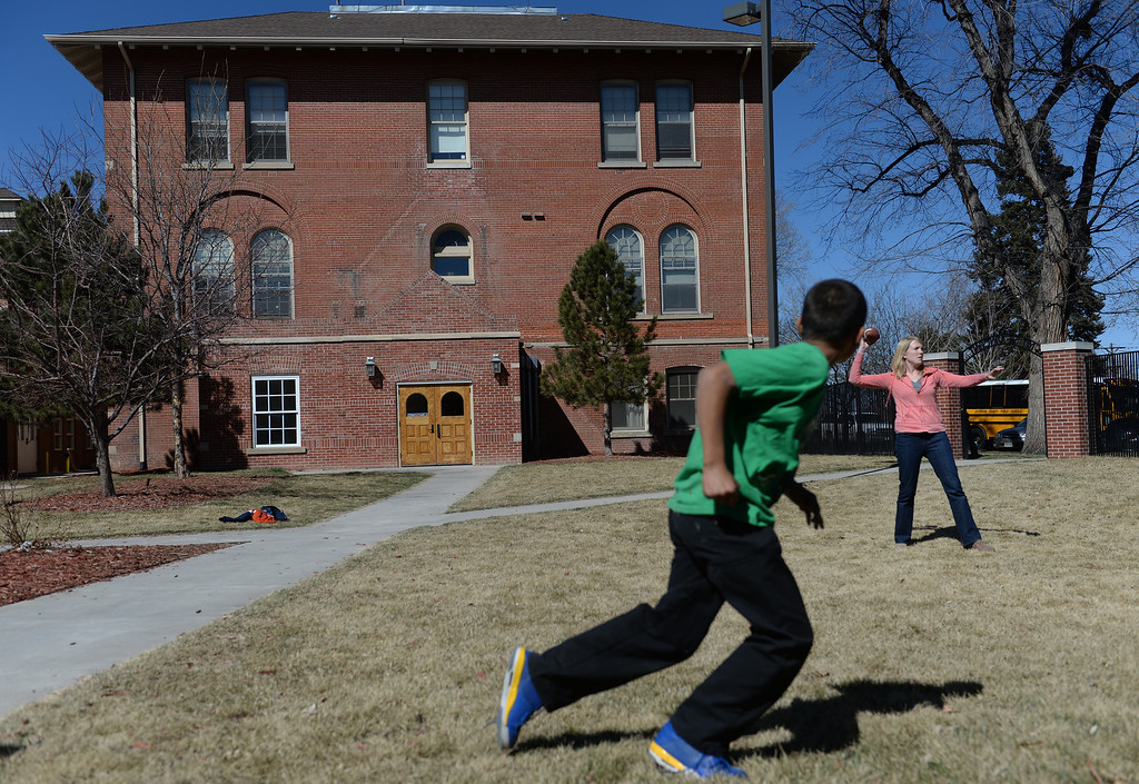 . After school kids get the opportunity to have some fun playing football with school therapist Teresa Egan, right, at Mount Saint Vincent Home in in Denver, Co.  (Photo By Helen H. Richardson/ The Denver Post).