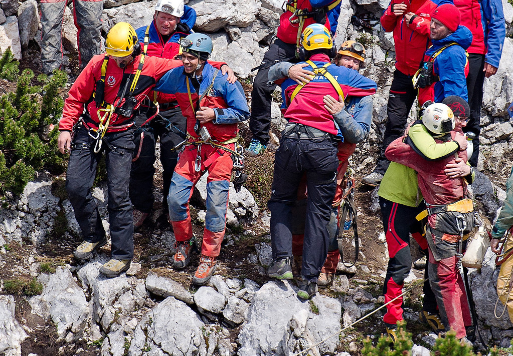 . Mountain rescuers  celebrate after they rescued cave researcher Johann Westhauser  out of the Riesending cave near Marktschellenberg, southern Germany, Thursday June 19, 2014.   (AP Photo/dpa,Nicolas Armer)