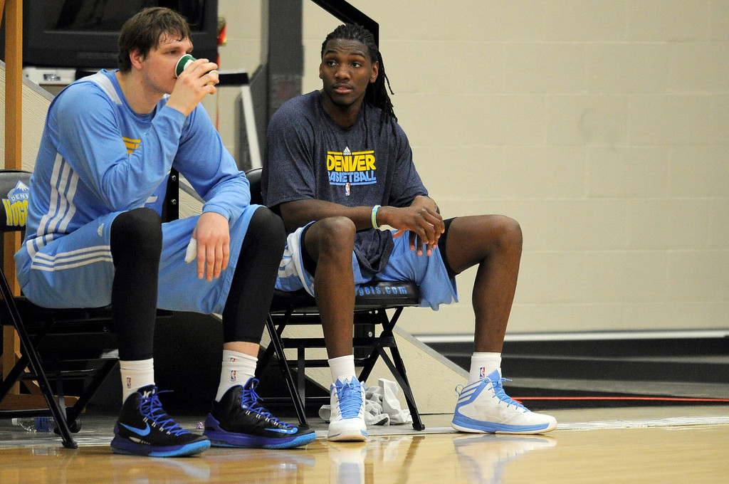 . Kenneth Faried (35) of the Denver Nuggets sits with Timofey Mozgov  during practice April 22, 2013 at Pepsi Center. The Denver Nuggets prepare for game two of the first round of the NBA playoffs against the Golden State Warriors. (Photo By John Leyba/The Denver Post)