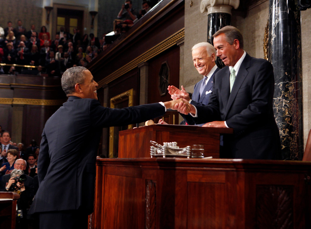 . President Barack Obama shakes hands with House Speaker John Boehner of Ohio, before he delivers the State of Union address before a joint session of Congress in the House chamber Tuesday, Jan. 28, 2014, in Washington, as Vice President Joe Biden watches. (AP Photo/Larry Downing, Pool)