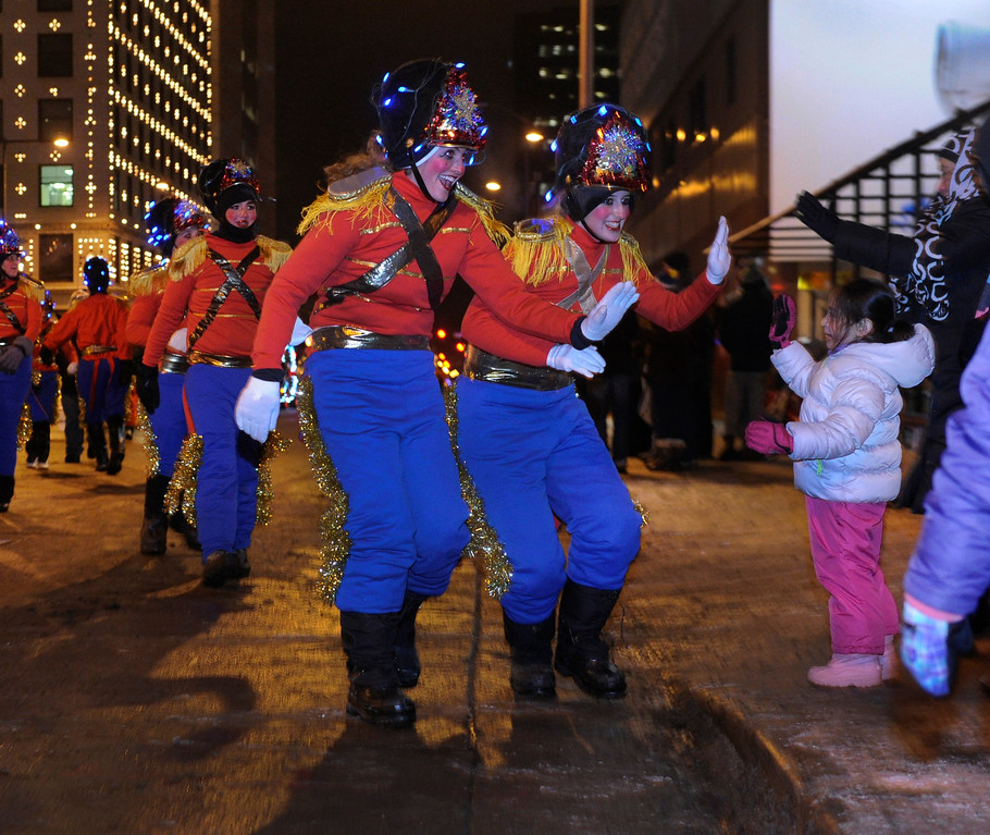 . DENVER, CO. - DECEMBER 06: Costumed tin soldiers greeted young fans waiting on the curb as the 9News Parade of Lights kicked off Friday night, December 6, 2013. The weather was clear but temperatures dipped below zero. Photo By Karl Gehring/The Denver Post