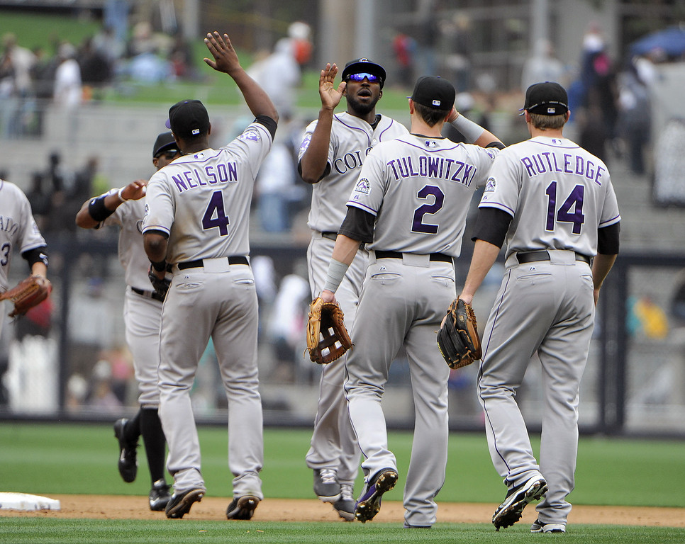 . Colorado Rockies players high-five after beating the San Diego Padres 2-1 in a baseball game at Petco Park on April 14, 2013 in San Diego, California.  (Photo by Denis Poroy/Getty Images)