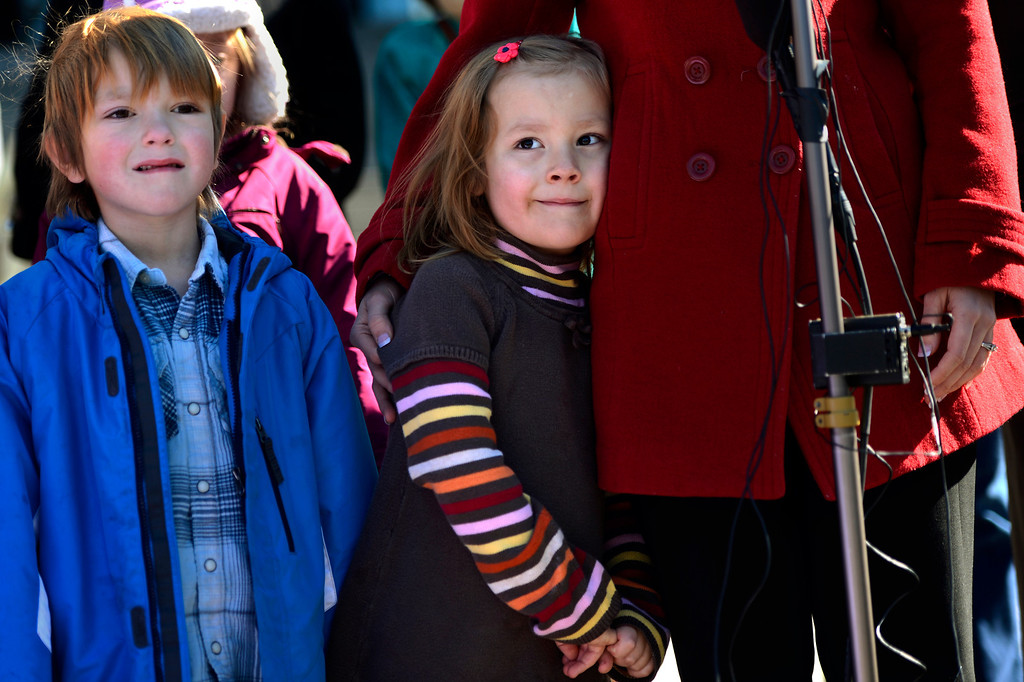 . Max Mathis 6, stands next to his sister 6-year-old Coy, under her mothers wing as Kathryn Mathis speaks during a press conference on the steps of the Denver State Capitol.(Photo By Joe Amon/The Denver Post)
