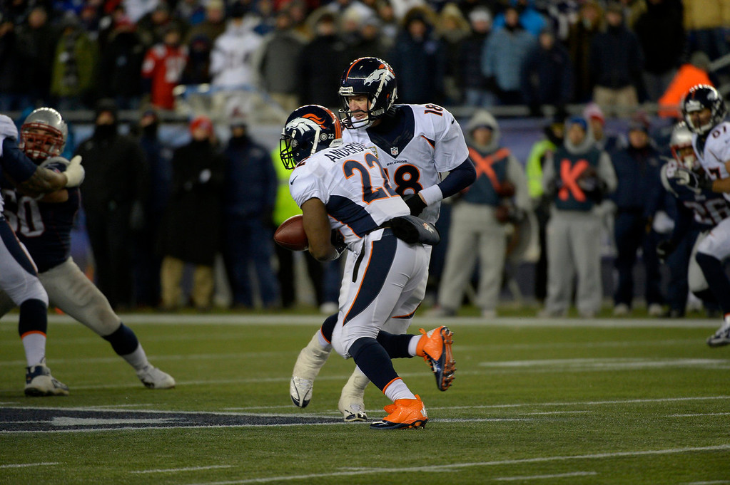 . Quarterback Peyton Manning #18 of the Denver Broncos and running back C.J. Anderson bobble a handoff in overtime. The patriots win 43-31 at Gillette Stadium in Foxborough MA, November 24, 2013 Denver. (Photo By Joe Amon/The Denver Post)