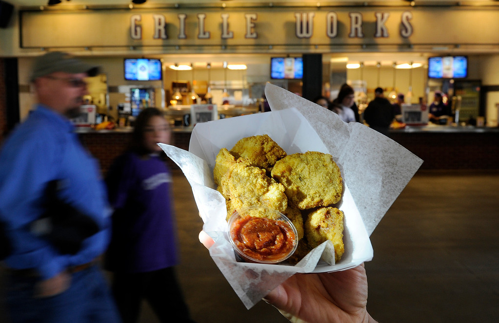 . Between the bratwurst and the chicken sandwich  at Grille Works one can find Rocky Mountain Oysters at the Denver  baseball park on May 3, 2013 before the Rockies game. (Photo By Cyrus McCrimmon/The Denver Post)