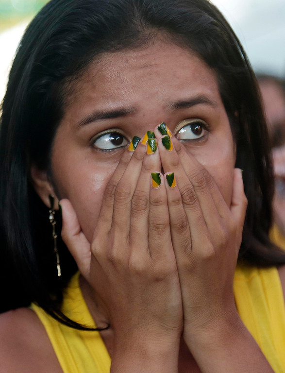 . A fan watches intently as Brazil plays Cameroon during the 2014 soccer World Cup in Manaus, Brazil, Monday, June 23, 2014.  (AP Photo/Marcio Jose Sanchez)
