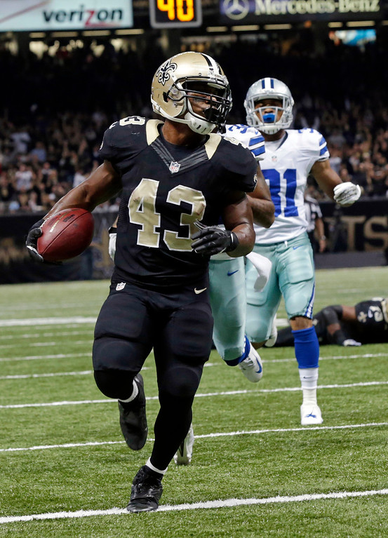 . New Orleans Saints running back Darren Sproles (43) carries for a touchdown in front of Dallas Cowboys cornerback Orlando Scandrickin the first half of an NFL football game in New Orleans, Sunday, Nov. 10, 2013. (AP Photo/Dave Martin)