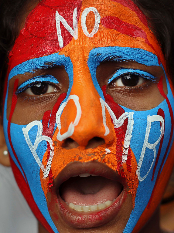 . An Indian student with painted face participates in a Hiroshima Day peace rally in Mumbai, India, Tuesday, Aug. 6, 2013.  (AP Photo/Rafiq Maqbool)