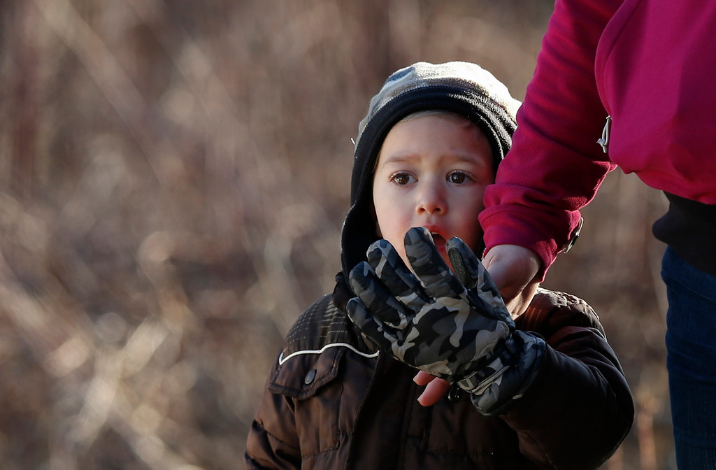 . A child reacts to police and fireman staged nearby Sandy Hook Elementary School where a gunman opened fire on school children and staff in Newtown, Connecticut on December 14, 2012. A heavily armed gunman opened fire on school children and staff at a Connecticut elementary school on Friday, killing at least 26 people, including 18 children, in the latest in a series of shooting rampages that have tormented the United States this year.     REUTERS/Adrees Latif