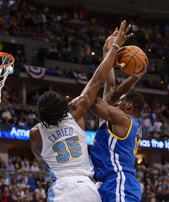 . Denver Nuggets small forward Kenneth Faried (35) defends a Golden State Warriors center Festus Ezeli (31) shot in the fourth quarter. The Denver Nuggets took on the Golden State Warriors in Game 5 of the Western Conference First Round Series at the Pepsi Center in Denver, Colo. on April 30, 2013. (Photo by John Leyba/The Denver Post)
