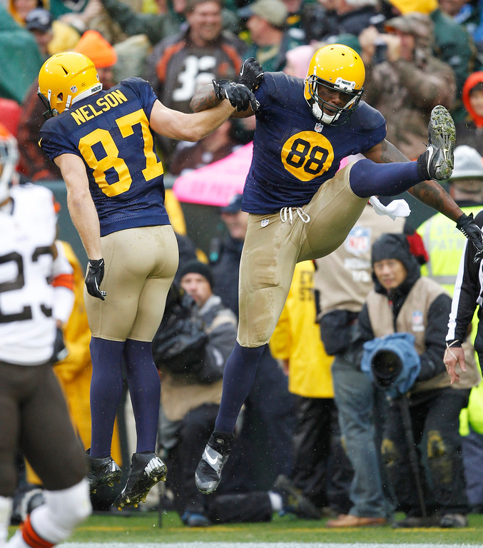 . Green Bay Packers\' Jermichael Finley (88) celebrates his touchdown catch with teammate Jordy Nelson (87) during the first half of an NFL football game against the Cleveland Browns Sunday, Oct. 20, 2013, in Green Bay, Wis. (AP Photo/Mike Roemer)