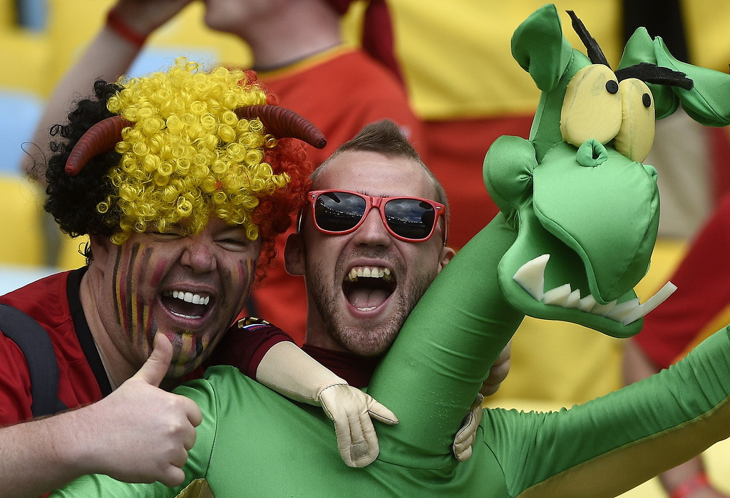 . Belgium\'s supporters joke as they wait for the start of the Group H football match between Belgium and Russia at the Maracana Stadium in Rio de Janeiro during the 2014 FIFA World Cup on June 22, 2014.   MARTIN BUREAU/AFP/Getty Images
