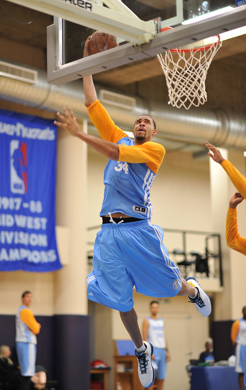 . JaVale McGee of Denver Nuggets (34) makes a basket during the team practice at Pepsi Center. Denver, Colorado. October 2, 2013. (Photo by Hyoung Chang/The Denver Post)