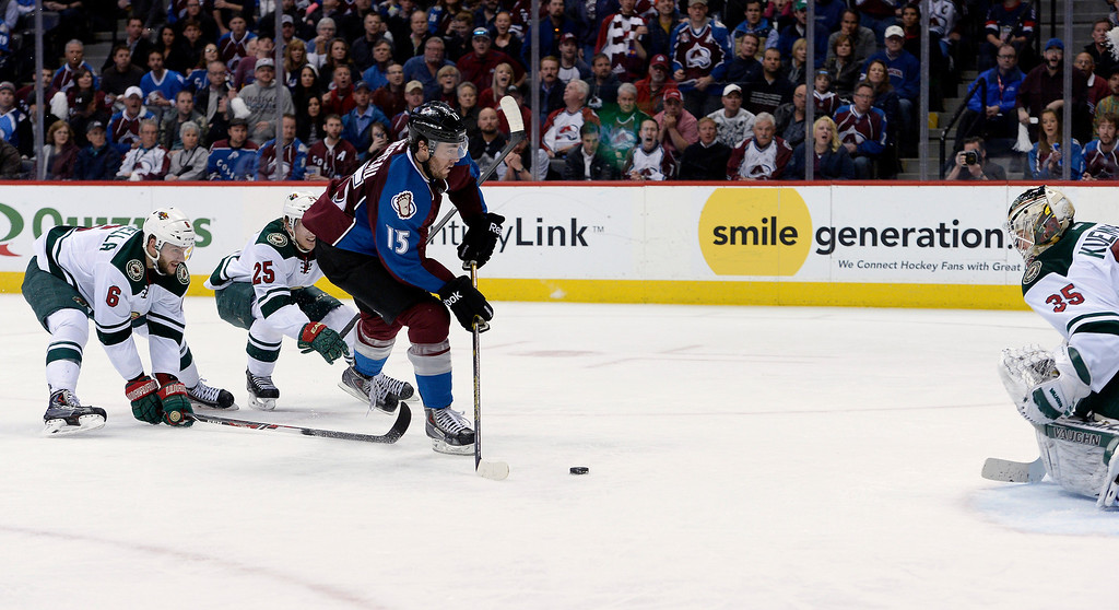 . Colorado Avalanche right wing P.A. Parenteau (15) charges Minnesota Wild goalie Darcy Kuemper (35) during the third period. (Photo by John Leyba/The Denver Post)
