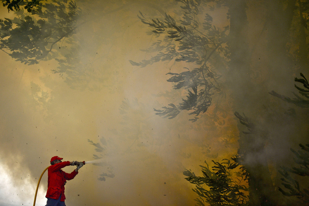 . A firefighter helps combat a wildfire around Caramulo, central Portugal, on August 30, 2013.    AFP PHOTO / PATRICIA DE MELO MOREIRA/AFP/Getty Images