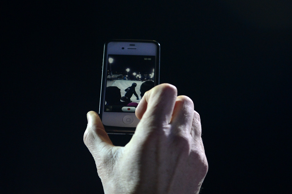 . ASPEN, CO - JANUARY 27: A fan makes a video of Shaun White\'s first run witih an iPhone during the men\'s snowboard superpipe final. X Games Aspen Buttermilk Mountain January 27, 2013. (Photo By AAron Ontiveroz/The Denver Post)