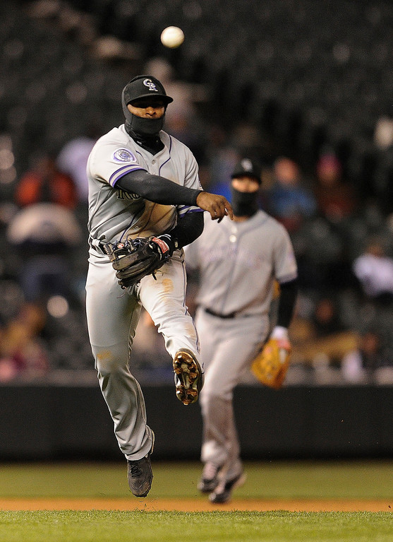 . DENVER, CO. - APRIL 16:  Rockies 3B Chris Nelson throws out Mets batter Anthony Recker in the fourth inning. The Colorado Rockies hosted the New York Mets in the second game of a doubleheader Tuesday night, April 16, 2013. Monday night\'s game was snowed out at Coors Field.  Photo By Karl Gehring/The Denver Post)