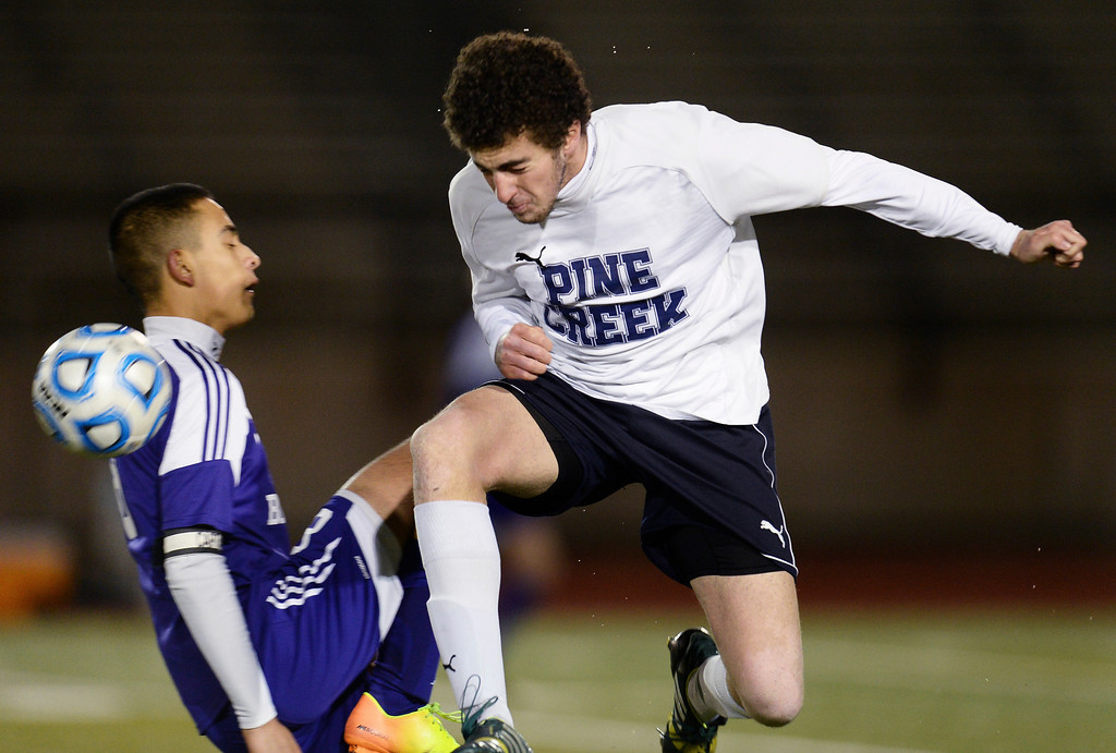 . Jay Morales of Pine Creek High School, right, battles for the ball with Javier Castruita of Boulder High School (8) in the second half. (Photo by Hyoung Chang/The Denver Post)