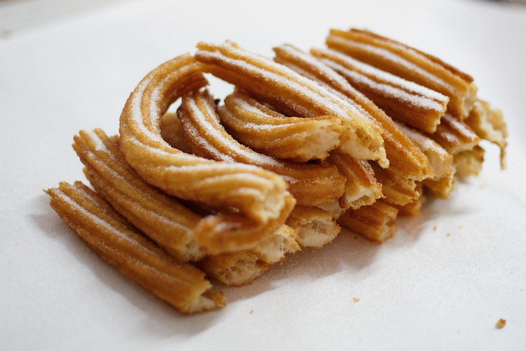 . PAMPLONA, SPAIN - JULY 11:  A detail view of a portion of \'churros\' at Churreria Manueta in the early morning during the sixth day of the San Fermin Running Of The Bulls festival on July 11, 2013 in Pamplona, Spain. Churreria de la Manueta has been making \'churros\' since 1872 in a traditional way. The annual Fiesta de San Fermin, made famous by the 1926 novel of US writer Ernest Hemmingway \'The Sun Also Rises\', involves the running of the bulls through the historic heart of Pamplona, this year for nine days from July 6-14.  (Photo by Pablo Blazquez Dominguez/Getty Images)