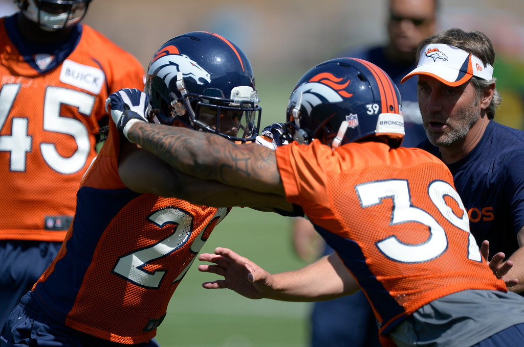 . Denver Broncos Bradley Roby (29) works on drills with Louis Young (39) during OTAs June 11, 2014 at Dove Valley. (Photo by John Leyba/The Denver Post)