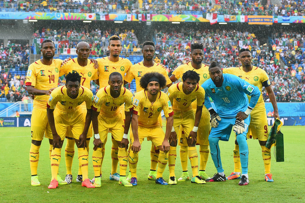 . Cameroon players pose for a team photo before the 2014 FIFA World Cup Brazil Group A match between Mexico and Cameroon at Estadio das Dunas on June 13, 2014 in Natal, Brazil.  (Photo by Matthias Hangst/Getty Images)