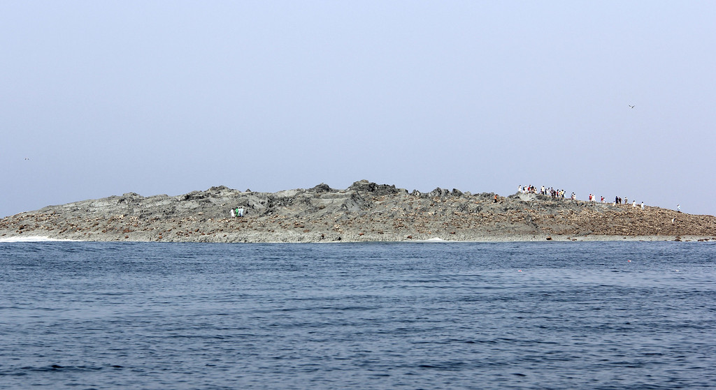 . This photograph taken on September 25, 2013, shows Pakistani residents as they gather on an island that appeared some two kilometres off the coastline of Gwadar after an earthquake. A small island of mud and rock created by the huge earthquake that hit southwest Pakistan has fascinated locals but experts -- who found methane gas rising from it -- say it is unlikely to last long. The 7.7-magnitude quake struck on September 24, in Baluchistan\'s remote Awaran district, killing at least 271 people and affecting hundreds of thousands. BEHRAM BALOCH/AFP/Getty Images