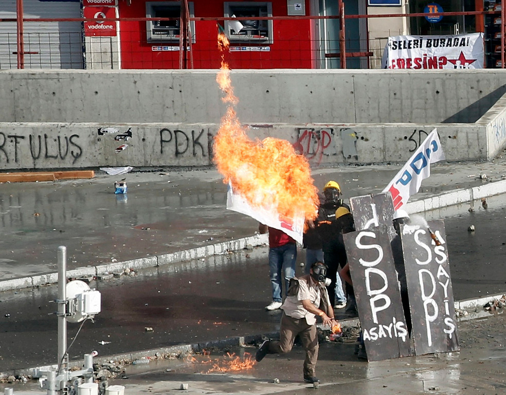 . A protester throws a petrol bomb at riot police during a protest at Taksim Square in Istanbul June 11, 2013.   REUTERS/Osman Orsal