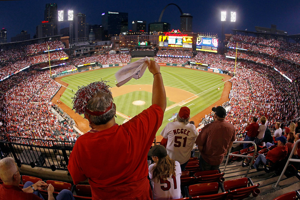 . St. Louis Cardinals fan Dawn Schallenberg, of Bethalto, Ill., cheers as the Cardinals are introduced before Game 5 of a National League baseball division series against the Pittsburgh Pirates on Wednesday, Oct. 9, 2013, in St. Louis. (AP Photo/Mark Humphrey)