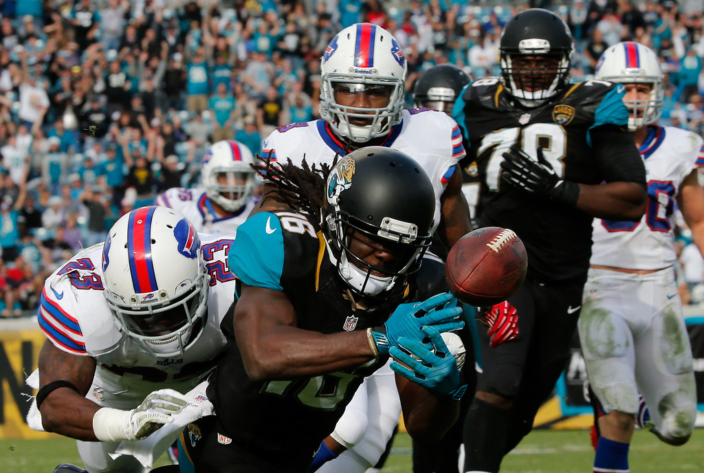 . Denard Robinson #16 of the Jacksonville Jaguars fumbles while crossing the goal line during the game against the Buffalo Bills at EverBank Field on December 15, 2013 in Jacksonville, Florida.  (Photo by Sam Greenwood/Getty Images)