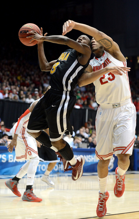 . DAYTON, OH - MARCH 22: Tavon Sledge #3 of the Iona Gaels drives to the basket against Amir Williams #23 of the Ohio State Buckeyes in the second half during the second round of the 2013 NCAA Men\'s Basketball Tournament at UD Arena on March 22, 2013 in Dayton, Ohio.  (Photo by Jason Miller/Getty Images)