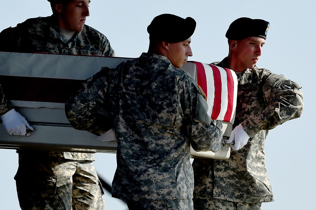 . U.S. Army soldiers carry the flag-draped transfer case containing the remains of U.S. Army Maj. Gen. Harold J. Greene during a dignified transfer at Dover Air Force Base on August 7, 2014 in Dover, Delaware. According to reports, Greene, who was from Schenectady, New York, assigned to the Combined Security Transition Command, was killed after his unit was attacked in Afghanistan. (Photo by Patrick Smith/Getty Images)
