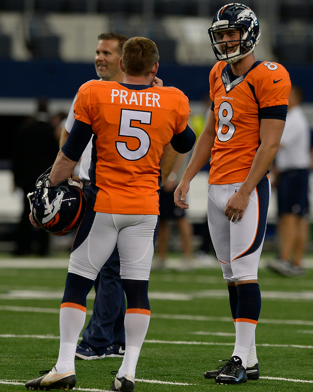 . ARLINGTON, TX - AUGUST 28: Denver Broncos K Brandon McManus (8) talks with Denver Broncos kicker Matt Prater (5) during warms up before their game agains the Dallas Cowboys August 28, 2014 at AT&T Stadium.  (Photo by John Leyba/The Denver Post)