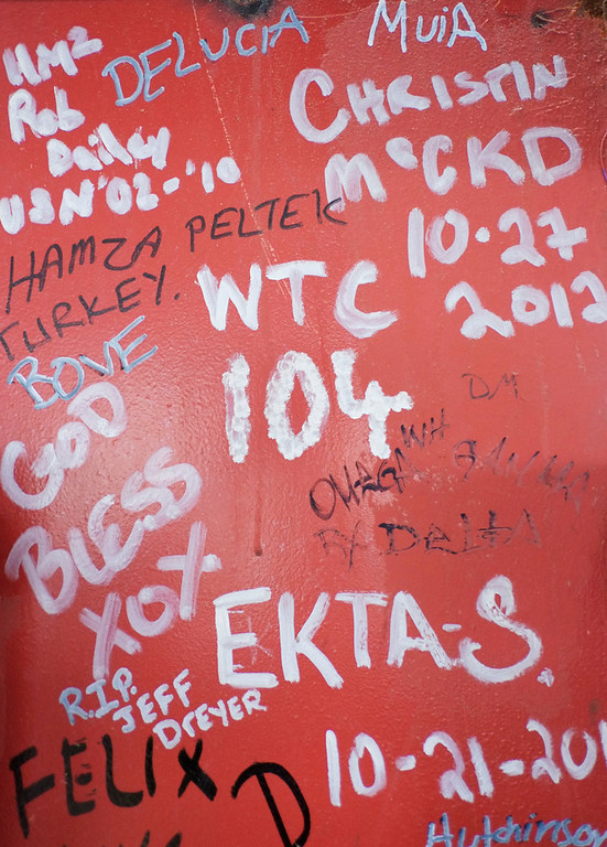 . This Jan. 15, 2013 photo shows graffiti left by workers on a steel column on the 104th floor of One World Trade Center in New York. Construction workers finishing New York\'s tallest building at the World Trade Center are leaving their personal marks on the concrete and steel in the form of graffiti. (AP Photo/Mark Lennihan)