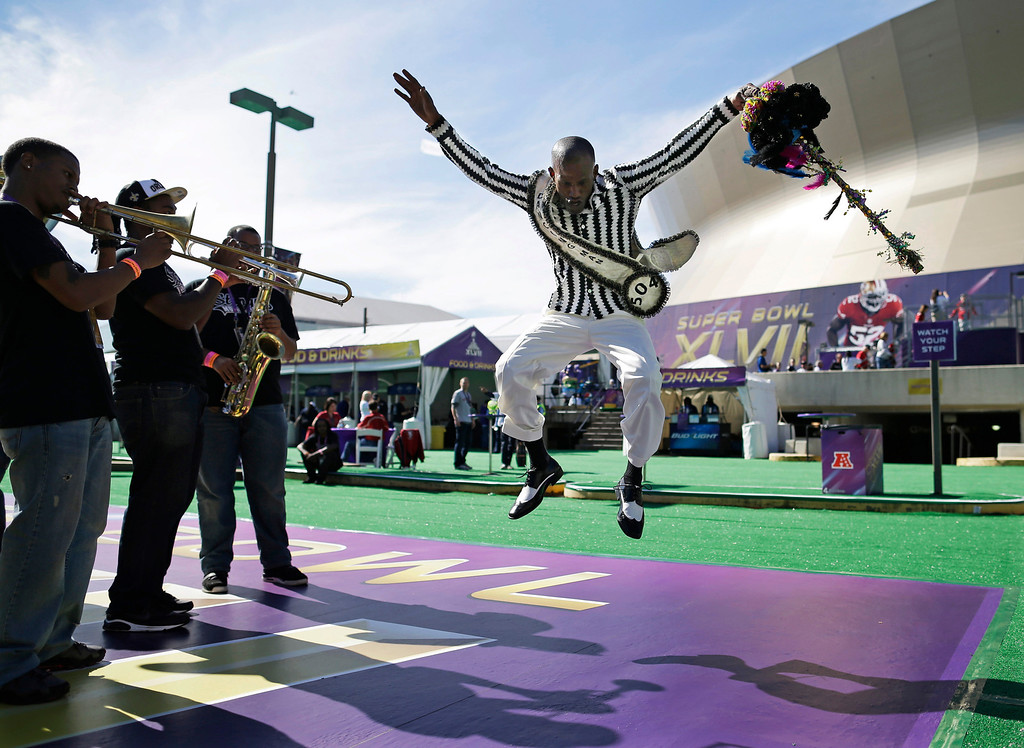 . Darryl Young performs outside the Superdome before the NFL Super Bowl XLVII football game between the San Francisco 49ers and the Baltimore Ravens Sunday, Feb. 3, 2013, in New Orleans. (AP Photo/Evan Vucci)