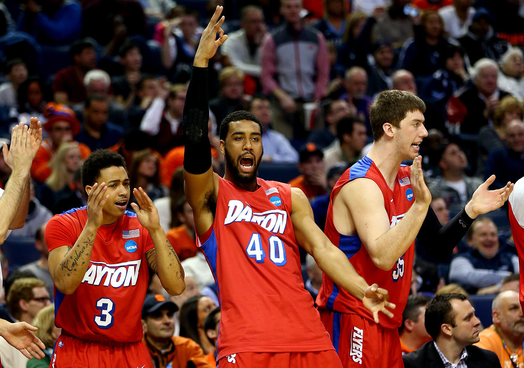 . BUFFALO, NY - MARCH 22: Devon Scott #40 and Kyle Davis #3 of the Dayton Flyers react on the bench during the third round of the 2014 NCAA Men\'s Basketball Tournament against the Syracuse Orange at the First Niagara Center on March 22, 2014 in Buffalo, New York.  (Photo by Elsa/Getty Images)