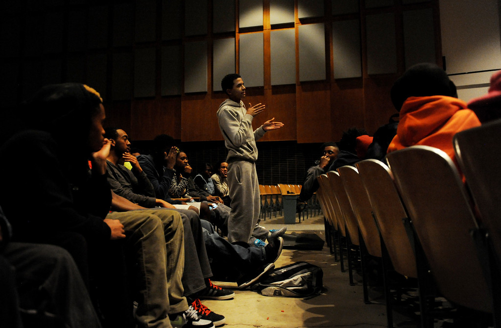 . Cameron Conners, a senior at George Washington High School, asks a question to a panel of Black Men in Support of Education, a group of successful black men who mentor kids, on March 26 at the high school in Denver, Colo. Photo by Jamie Cotten, Special to The Denver Post