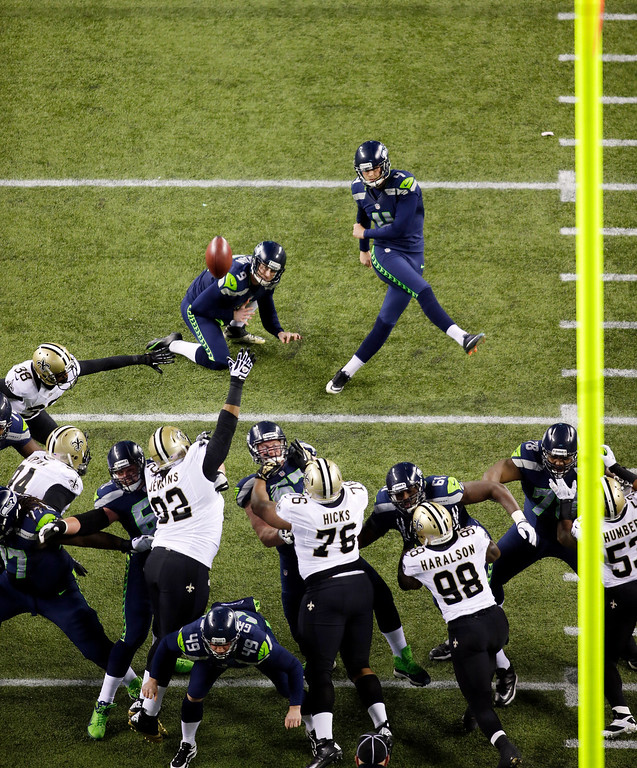 . Seattle Seahawks kicker Steven Hauschka, upper right, kicks a field goal as Seahawks\' Jon Ryan holds in the first half of an NFL football game against the New Orleans Saints, Monday, Dec. 2, 2013, in Seattle. (AP Photo/John Froschauer)