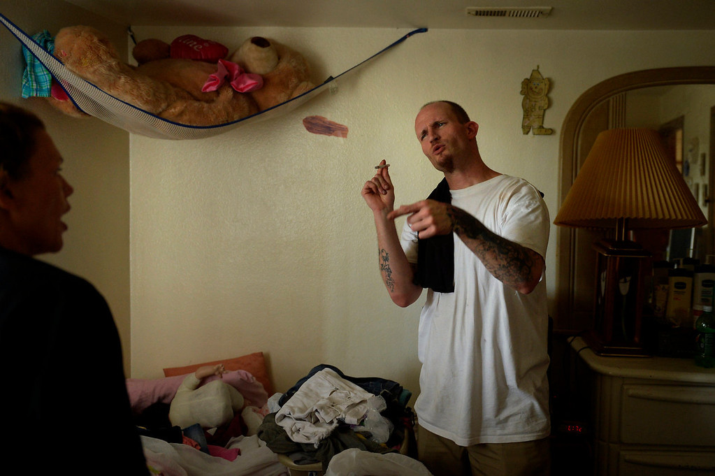 . Parolee Thomas Vescio, 35, and Nikki Christos, 34, talk as they straighten up the apartment where she and her two children live before she leaves for a voluntary 72-hour detox on July 24, 2013 in Thornton, Colorado.  (Photo By Joe Amon/The Denver Post)