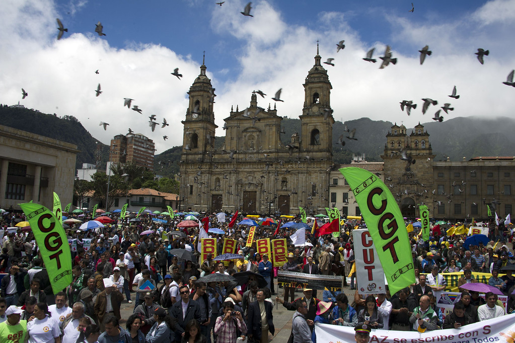. Activists attend a rally to support Colombian farmworkers demanding government subsidies and greater access to land, in Bogota, Colombia, on August 20, 2013. Farmers who want Colombian President Juan Manuel Santos to set up a national dialogue to discuss land and other issues affecting farmworkers, are being joined by truckers, miners and health and education workers in nationwide roadblocks, rallies and demonstrations that began on Monday.  EITAN ABRAMOVICH/AFP/Getty Images