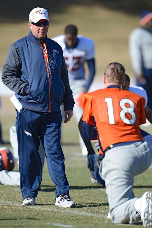 . Denver Broncos head coach John Fox  talks with Denver Broncos quarterback Peyton Manning (18) during practice Wednesday, January 9, 2013 at Dove Valley.  John Leyba, The Denver Post