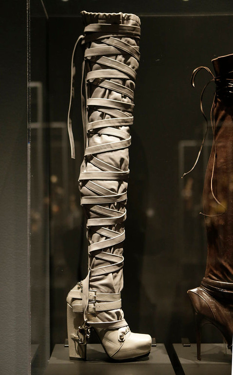 """. A thigh-high boot designed by Nicholas Kirkwood for the Rodarte Spring 2009 fashion show at the \""""Shoe Obsession\"""" exhibit at The Museum at the Fashion Institute of Technology Museum in New York. The exhibition, showing off 153 specimens, runs through April 13. (AP Photo/Kathy Willens)"""