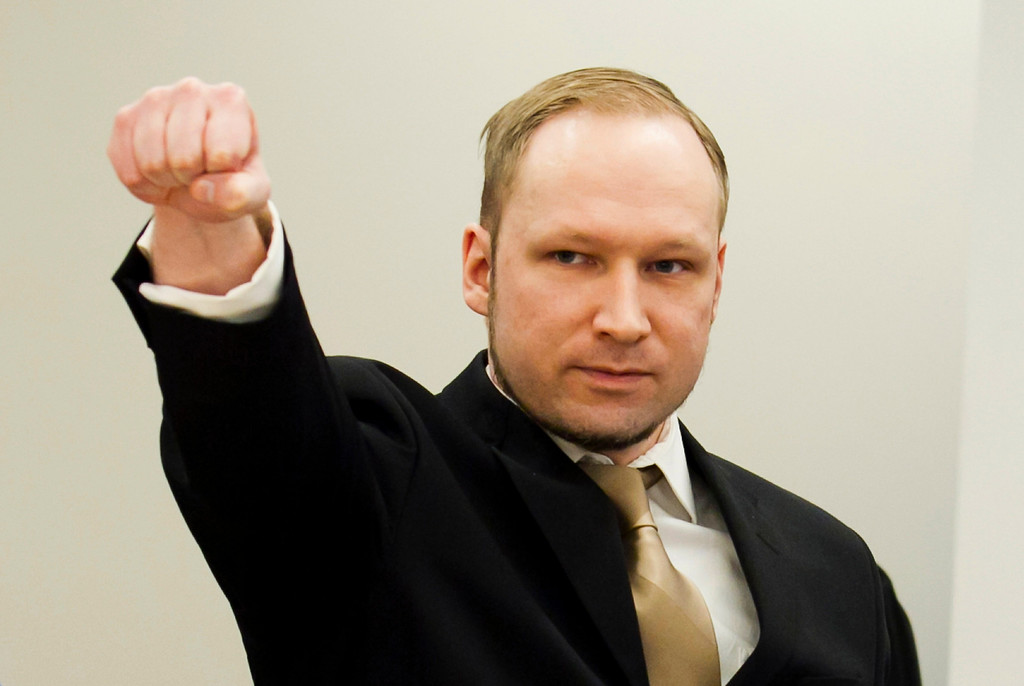 . Norwegian mass killer Anders Behring Breivik gestures as he arrives for his terrorism and murder trial in a courtroom in Oslo April 16, 2012. Breivik, who massacred 77 people last summer, arrived under heavy armed guard at an Oslo courthouse on Monday, lifting his arm in what he has called a rightist salute as his trial began. Breivik, 33, has admitted setting off a car bomb that killed eight people at government headquarters in Oslo last July, then massacring 69 in a shooting spree at an island summer camp for Labour Party youths. REUTERS/Heiko Junge/Pool