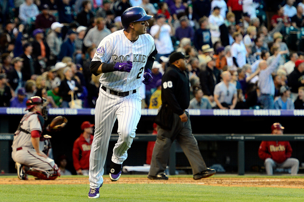 . DENVER, CO - MAY 21: Troy Tulowitzki (2) of the Colorado Rockies hits a solo home run off of Ian Kennedy (31) of the Arizona Diamondbacks during action at Coors Field. The Arizona Diamondbacks visited the Colorado Rockies. (Photo by AAron Ontiveroz/The Denver Post)
