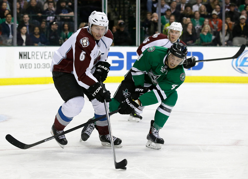 . Colorado Avalanche\'s Erik Johnson (6) and Dallas Stars\' Brenden Dillon (4) compete for control of a loose puck in the first period of an NHL hockey game, Monday, Jan. 27, 2014, in Dallas. (AP Photo/Tony Gutierrez)
