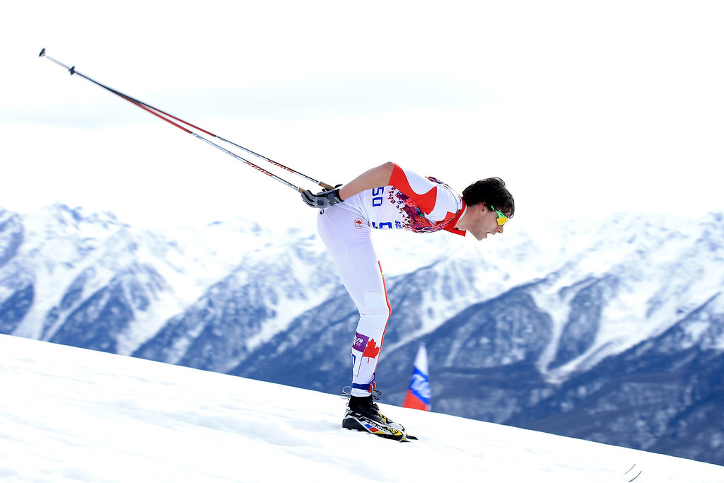 . SOCHI, RUSSIA - FEBRUARY 14:  Alex Harvey of Canada competes in the Men\'s 15 km Classic during day seven of the Sochi 2014 Winter Olympics at Laura Cross-country Ski & Biathlon Center on February 14, 2014 in Sochi, Russia.  (Photo by Richard Heathcote/Getty Images)