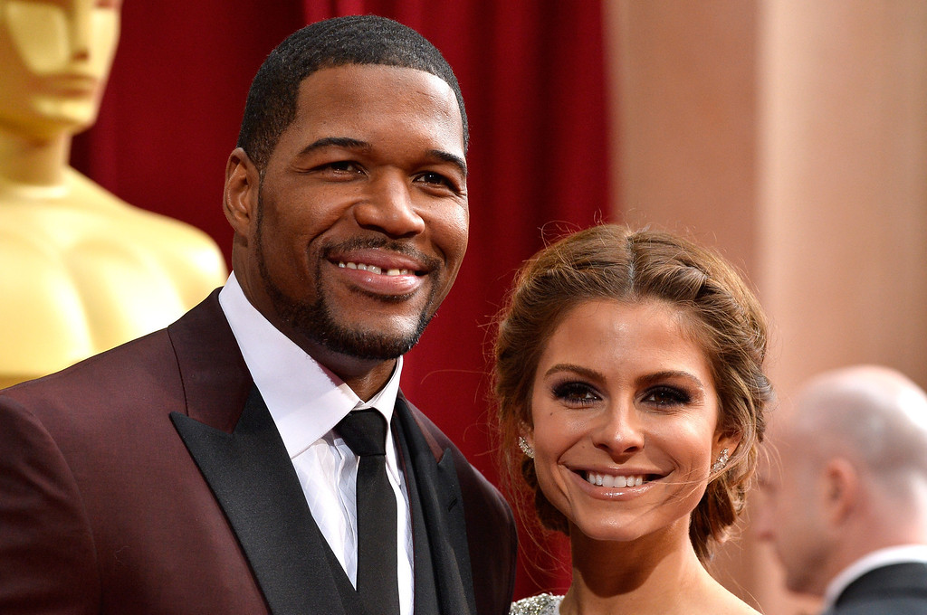 . TV personalities Michael Strahan (L) and Maria Menounos attend the Oscars held at Hollywood & Highland Center on March 2, 2014 in Hollywood, California.  (Photo by Frazer Harrison/Getty Images)