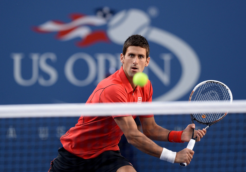 . Novak Djokovic of Serbia returns a shot to Rafael Nadal of Spain during the 2013 US Open men\'s singles final at the USTA Billie Jean King National Tennis Center September 9, 2013 in New York.    STAN HONDA/AFP/Getty Images
