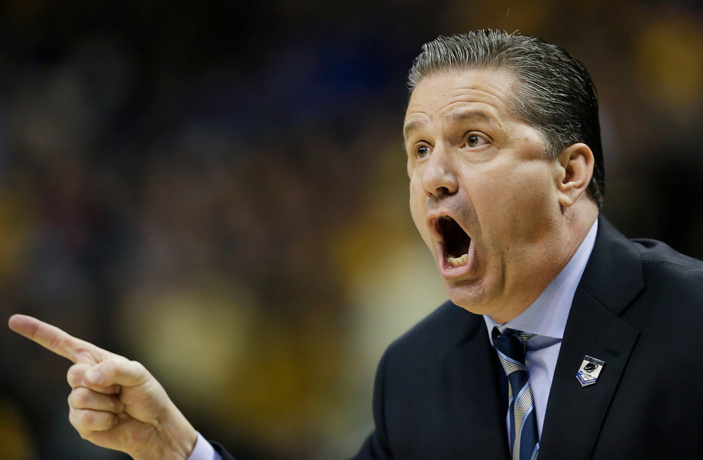 . Kentucky head coach John Calipari works from the sideline against Wichita State  during the first half of a third-round game of the NCAA college basketball tournament Sunday, March 23, 2014, in St. Louis. (AP Photo/Charlie Riedel)